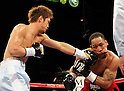 (L-R) Nobuhiro Ishida (JPN), James Kirkland (USA), APRIL 9, 2011 - Boxing : Nobuhiro Ishida of Japan hits James Kirkland of the United States during the 8R middle weight bout at MGM Grand Garden Arena in Las Vegas, Nevada, USA. (Photo by Naoki Fukuda/AFLO)