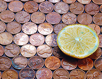 LEMON REMOVES COPPER TARNISH (2 of 2)<br /> Citric Acid and Copper Oxide<br /> A circle of shiny pennies is caused by the reaction between citric acid of the lemon &amp; the copper tarnish.