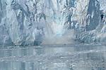 Calving, or huge chunks of ice breaking off, at Marjorie Glacier in Glacier Bay National Park, Alaska