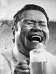 Popular Japanese comedian actor advertising a Japanese beer by appealing to the average salary man (office worker) who often likes to drink with colleagues after work.