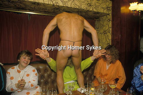 Girls Night Out. Hen party evening South London pub. Male strippers perform for a girls only evening. Circa 1980s
