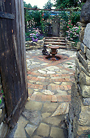 Secret garden with brick and stone pavers, behind door, with child statues 4125