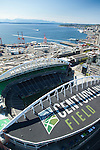 aerial photo of Seatle's Century Link Field with Port of Seattle and Elliott Bay in the background