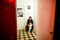 Nick Zedd with his son in his apartment in the Condesa, Mexico City.  Part of the Moving Portrait series.  Mexico DF