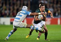 Handre Pollard of South Africa is tackled by Juan Manuel Leguizamon of Argentina. Rugby World Cup Bronze Final between South Africa and Argentina on October 30, 2015 at The Stadium, Queen Elizabeth Olympic Park in London, England. Photo by: Patrick Khachfe / Onside Images