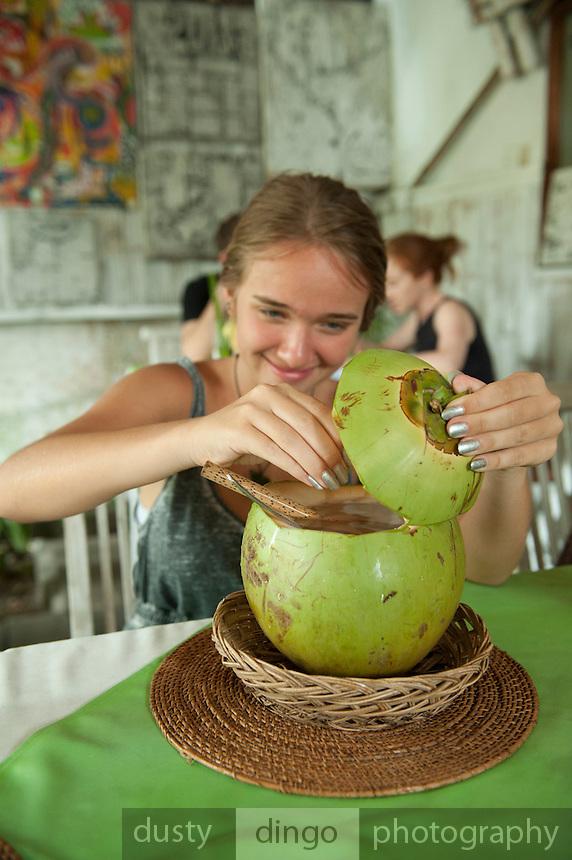 Eloise tackling a coconut.<br /> Sanur, Bali