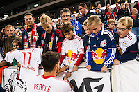 Heath Pearce (3) of the New York Red Bullssaigns autographs for fans after the match. The New York Red Bulls and Sporting Kansas City played to a 0-0 tie during a Major League Soccer (MLS) match at Red Bull Arena in Harrison, NJ, on October 20, 2012.