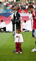 Chivas USA goalie Zach Thornton (22) and little Chivas USA fan during the National Anthem of the game between Chivas USA and the Philadelphia Union at the Home Depot Center in Carson, CA, on July 3, 2010. Chivas USA 1, Philadelphia Union 1.