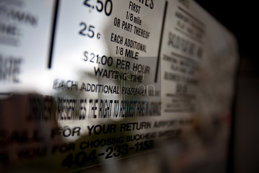Fares posted on the window of a taxi in Atlanta, Georgia.