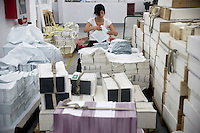 "An Amity Printing Company employee arranges newly-printed Bible pages in the Amity Printing Company's new printing facility in Nanjing, China....On May 18, 2008, the Amity Printing Company in Nanjing, Jiangsu Province, China, inaugurated its new printing facility in southern Nanjing.  The facility doubles the printing capacity of the company, now up to 12 million Bibles produced in a year, making Amity Printing Company the largest producer of Bibles in the world.  The company, in cooperation with the international organization the United Bible Societies, produces Bibles for both domestic Chinese use and international distribution.  The company's Bibles are printed in Chinese and many other languages.  Within China, the Bibles are distributed both to registered and unregistered Christians who worship in illegal ""house churches."""
