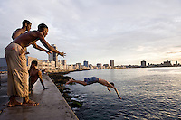 Havana, Cuba<br /> In Cuba, a country devoid of technical distractions, the vibrancy of life spills into the streets. At the end of the day men convene in the streets to play a rowdy game of dominos. Teenagers practice their steps for their upcoming Quincea&ntilde;era dance, while women gossip and show off their babies. On every street corner children entertain themselves for hours playing baseball with a stick and an old bottle cap. In Havana, much of the local social life is experienced around the Malecon. The main purpose of building this wall in 1901 was to protect the city from rising ocean water, but this esplanade has become a haven for fisherman, a promenade for lovers and a social gathering place for friends.