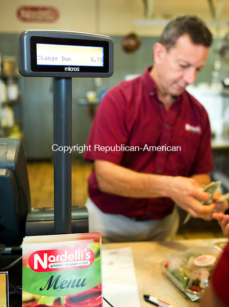 Waterbury, CT- 30 September 2015-093015CM03- Stewart Rosen, owner at the Nardelli's on Watertown Ave. rings out a customer in Waterbury on Wednesday.  The restaurant will be acquiring a new Point of Service (POS) register.      Christopher Massa Republican-American