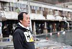 Fisherman Toshiyuki Maekawa stands outside the ruined fish market in the historic city of Kamaishi, Iwate Prefecture, Japan on 04 April, 2011. .Photographer: Robert Gilhooly