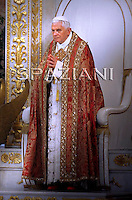 Pope Benedict XVI leaves after the first Vesper at Rome's St. Paul Outside the Walls Basilica on June 28, 2010.