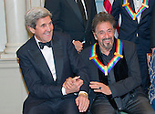 United States Secretary of State John Kerry, left, shakes hands with actor Al Pacino, right, as they prepare prepare to pose The five recipients of the 39th Annual Kennedy Center Honors pose for a group photo following a dinner hosted by United States Secretary of State John F. Kerry in their honor at the U.S. Department of State in Washington, D.C. on Saturday, December 3, 2016.  The 2016 honorees are: Argentine pianist Martha Argerich; rock band the Eagles; screen and stage actor Al Pacino; gospel and blues singer Mavis Staples; and musician James Taylor.<br /> Credit: Ron Sachs / Pool via CNP