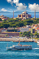 Sarayburnu or Seraglio Point with a ferry and the banks of the Golden Horn in the foreground, Istanbul Turkey.