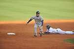 Ole Miss' Will Jamison (4) is safe at second vs. UT-Martin's Wes Piersall at Oxford-University Stadium in Oxford, Miss. on Wednesday, February 20, 2013. Ole Miss won 15-2 to improve to 4-0.