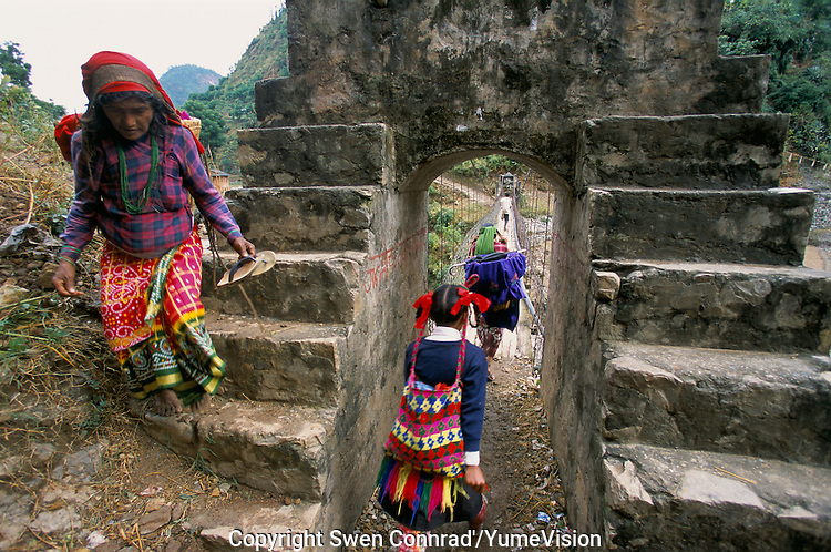 Farmer and school girl at the Sulichour bridge in Rolpa District, Nepal