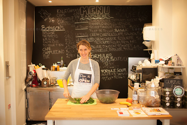 Kristen Beddard, 29, of The Kale Project, prepares a kale salad at The Superfoods Cafe in Paris, France.  Kevin German / Luceo