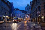 A tram winds through the Mala Strana neighborhood at dusk, Prague, Czech Republic, Europe