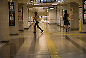 People walking through the underground shopping mall to the underground train station on a Sunday evening.
