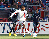 New England Revolution defender Jose Goncalves (23) passes the ball.   In a Major League Soccer (MLS) match, Sporting Kansas City (blue) tied the New England Revolution (white), 0-0, at Gillette Stadium on March 23, 2013.