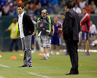 Chivas USA head coach Martin Vassquez(white shirt) observing his team from the sideline. USA Chivas USA defeated Pachuca FC 1-0 during 2010 SuperLiga group play at Home Depot Center stadium in Carson, California Wednesday July 21, 2010.
