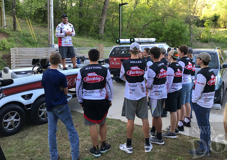 Courtesy photo<br />HOOK, LINE, LEADERS<br />Greg Bohannan of Bentonville, a Walmart FLW Tour pro angler, does one of his Hook, Line and Leaders programs on April 15 with members of the Northwest Arkansas Youth Anglers. Bohannan does a program at each FLW Tour stop to emphasize community involvement, education and leadership. Bohannan will compete in the Walmart FLW Tour bass tournament at Beaver Lake that begins on Thursday.