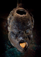 An oil lamp of an African head comes from Roman times, perhaps the second century, A.D.