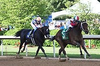 HOT SPRINGS, AR - April 15: Inside Straight #5 takes the lead from Midnight Storm #3 to win the Oaklawn Handicap at Oaklawn Park on April 15, 2017 in Hot Springs, AR. (Photo by Ciara Bowen/Eclipse Sportswire/Getty Images)