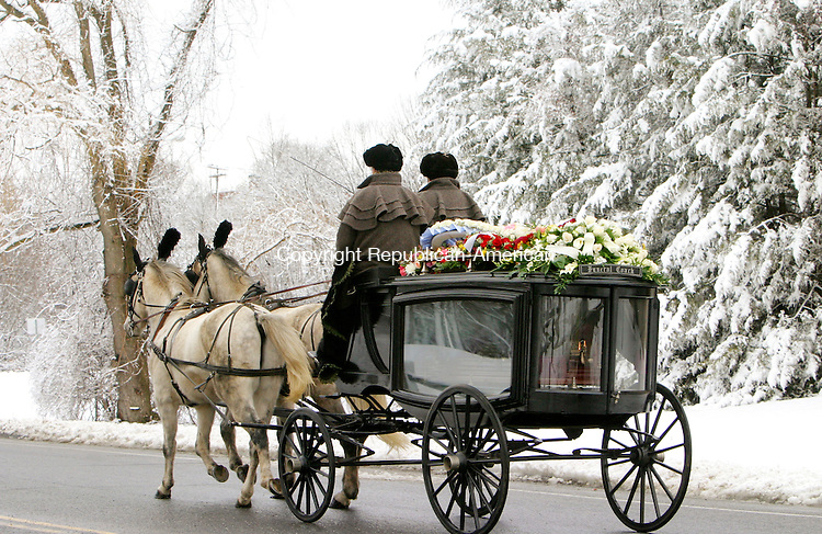 WATERBURY, CT. 14  January 2007-011408SV02--A horse drawn hearse carries Athanasios Kaloidis, owner of Spartan Restaurant, from the funeral home to the Holy Trinity Greek Orthodox Church on Chase Parkway in Waterbury Monday.<br /> Steven Valenti Republican-American