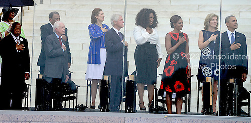From left to right: United States Representative John Lewis (Democrat of Georgia), Ambassador Andrew Young, former U.S. President Jimmy Carter, Lynda Bird Johnson Robb, former U.S. President Bill Clinton, Oprah Winfrey, first lady Michelle Obama, Ambassador Caroline Kennedy, and United States President Barack Obama listen to the National Anthem at the Let Freedom Ring ceremony on the steps of the Lincoln Memorial to commemorate the 50th Anniversary of the March on Washington for Jobs and Freedom.<br /> Credit: Ron Sachs / CNP