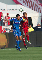 03 July 2013: Toronto FC midfielder Ryan Richter #33 and Montreal Impact midfielder Davy Arnaud #22 in action during an MLS game between the Montreal Impact and Toronto FC at BMO Field in Toronto, Ontario Canada.