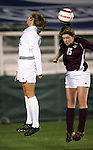 Boston College's Katie Coffey (r) and Duke's Sarah McCabe (l) challenge for a header on Wednesday, November 2nd, 2005 at SAS Stadium in Cary, North Carolina. The Duke University Blue Devils defeated the Boston College Eagles 2-0 during their Atlantic Coast Conference Tournament Quarterfinal game.