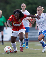 Second half substitute Western New York forward Jodi-Ann Robinson (9) with the ball, late in the game, in the penalty area fends off Boston Breakers defender Elli Reed (7). In a Women's Premier Soccer League Elite (WPSL) match, the Boston Breakers defeated Western New York Flash, 3-2, at Dilboy Stadium on May 26, 2012.