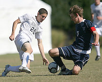 Andy Riemer #20 of Georgetwn University slides in to tackle Kyle McCathy #7 of Villanova University during a Big East match at North Kehoe Field, Georgetown University on October16 2010 in Washington D.C. Georgetown won 3-1.