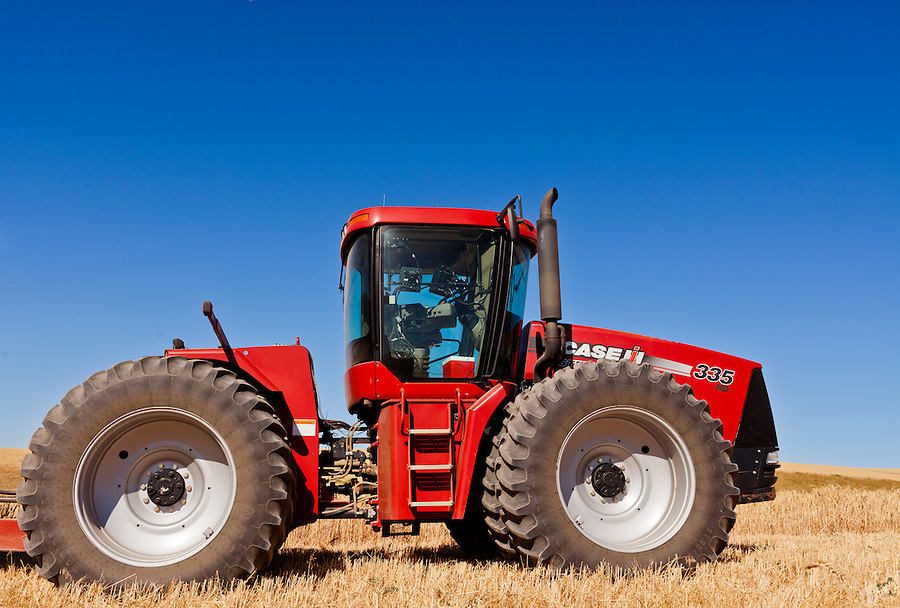 A Case 335 tractor with the blue sky in the background.