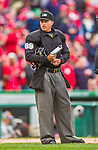 4 April 2014: Home Plate Umpire Cory Blaser stands at the plate between innings at the Washington Nationals Home Opening Game against the Atlanta Braves at Nationals Park in Washington, DC. The Braves edged out the Nationals 2-1 in their first meeting of the 2014 MLB season. Mandatory Credit: Ed Wolfstein Photo *** RAW (NEF) Image File Available ***