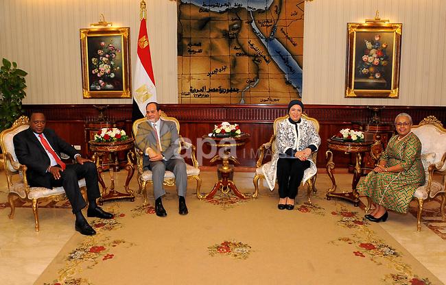 Egyptian President Abdel Fattah al-Sisi meets with Kenyan President Uhuru Kenyatta upon his arrival at Cairo's international airport in Cairo, Egypt, on May 10, 2017. Photo by Egyptian President Office