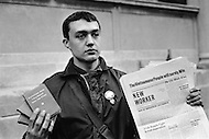"""December 1969, Manhattan, New York City, New York State, USA --- An American Maoist young man holding a New Worker with the headline """"The Vietnamese People will surely Win"""" and books of Chairman Mao during a Black Panthers demonstration in 1969. --- Image by © JP Laffont/Sygma/CORBIS"""