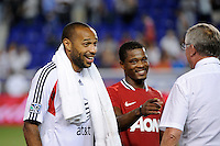 Thierry Henry (14) of the MLS All-Stars talks with manager Sir Alex Ferguson of Manchester United after the match. Manchester United defeated the MLS All-Stars 4-0 during the MLS ALL-Star game at Red Bull Arena in Harrison, NJ, on July 27, 2011.