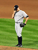 New York Yankees pitcher David Robertson (30) collects his thoughts after giving up an eighth inning home run against the Baltimore Orioles at Oriole Park at Camden Yards in Baltimore, Maryland on Monday, August 29, 2011.  The Yankees won the game 3 - 2..Credit: Ron Sachs / CNP.(RESTRICTION: NO New York or New Jersey Newspapers or newspapers within a 75 mile radius of New York City)