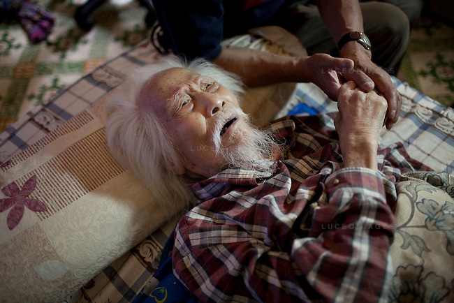 "Photographer Vo An Ninh, now 103 years old, lays practically motionless on a small mattress while his great grandchildren instant message friends on their computers. He looks like a small invalid child with an incredibly weathered face. But this man is one of the pioneering photographers of Vietnam, and he has seen more in his life than I can ever hope for...His photographs caught the essence of the Vietnamese people during the early years of photojournalism. His work during the French occupation and Vietnamese famines serve as historical records for the his nation. His access to Ho Chi Minh during war times as a photographer was impressive...In 1972, American b-52 bombers continuously hit Hanoi. Hanoians called this time the ""Sleepless Nights"". Despite government curfew orders during the air raids, many photographers stayed out to photograph. Vo An Ninh was one of those photographers. He was said to be very calm, riding a bicycle at a leisurely pace, with a helmet hanging from one handle bar and a canvas saddle bag on the other...His camera of choice, the Super Ikonta A - A Japanese 120 film rangefinder introduced in the 1950's. Many photographers offered him newer cameras but he would just laugh and ask, ""Why would I use one of those when I have this one?""..For his contributions to photography in Vietnam, Vo An Ninh has been awarded the Anti-US Order, Second Class; the Labour Order, Second Class; the Independence Order, Third Class and most recently, the coveted Ho Chi Minh Award."