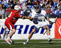 Justin Turri (12) of Duke tries to get past Dean Hart (12) of Maryland during the Face-Off Classic in at M&T Stadium in Baltimore, MD