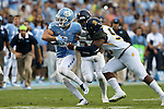 12 September 2015: UNC's Ryan Switzer (3) is tackled by NC A&T's Denzel Jones (56). The University of North Carolina Tar Heels hosted the North Carolina A&T State University Aggies at Kenan Memorial Stadium in Chapel Hill, North Carolina in a 2015 NCAA Division I College Football game.