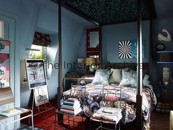 The guest bedroom is located at the top of the house and features a Zandberg-designed four-poster bed