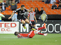 Washington D.C. - April 26, 2014:  Fabian Espindola (9) of D.C. United goes against Hendry Thomas (20) of FC Dallas. D.C. United defeated the FC Dallas 4-1 during a Major League Soccer match for the 2014 season at RFK Stadium.