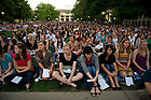 September 11, 2011; Students and guests sit on the lawn in Hesburgh Library Quad during a special outdoor mass of remembrance for the 911 attack victims at the University of Notre Dame. Photo by Barbara Johnston/University of Notre Dame