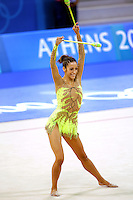 Almudena Cid of Spain mills with clubs at 2004 Athens Olympic Games during All-Around final on August 29, 2006 at Athens, Greece. (Photo by Tom Theobald)