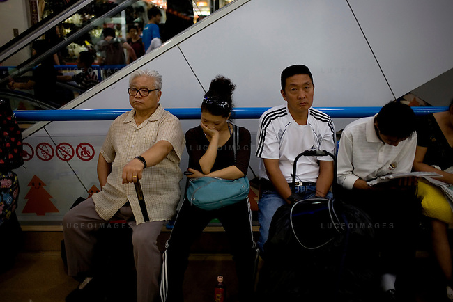 Locals take a rest from shopping at a mall in Beijing, China on Friday, August 22, 2008.  Kevin German